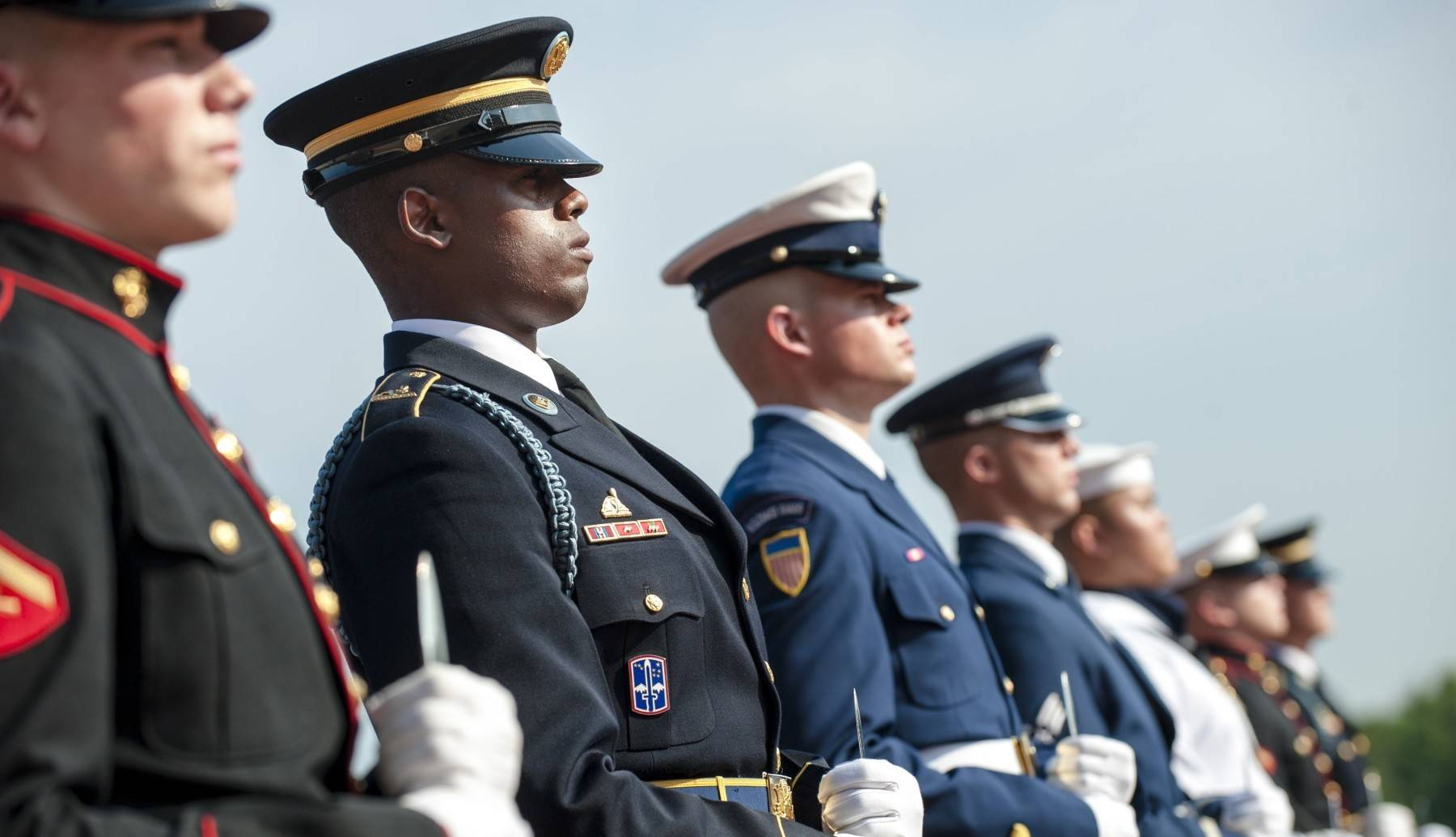 Members of all 5 branches of the military honor guard